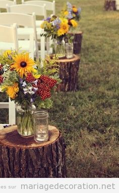 Troncs et fleurs por décorer un mariage à la campagne