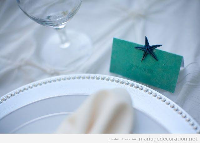 Décoration mariage pas cher, étoile de mer sur la carton avec le nom des invités