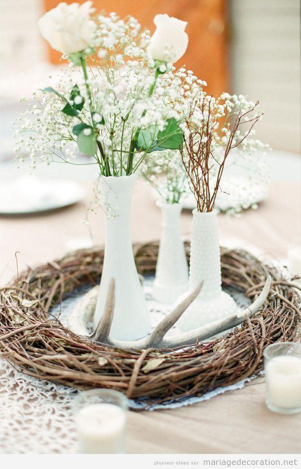 Un nid avec fleurs blanches, décoration centre table mariage