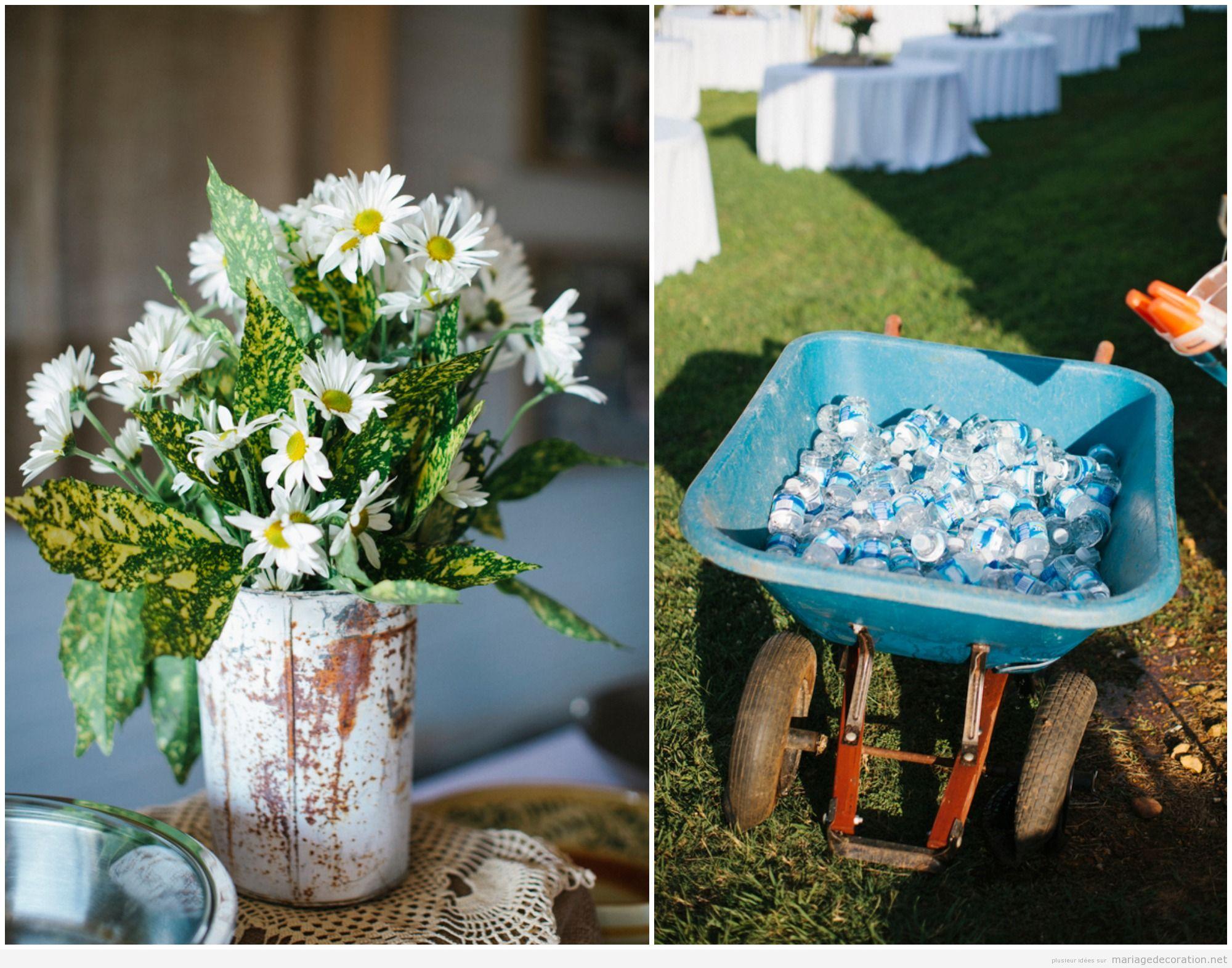Brouette et boîtes rouillés pour décorer un mariage rustique